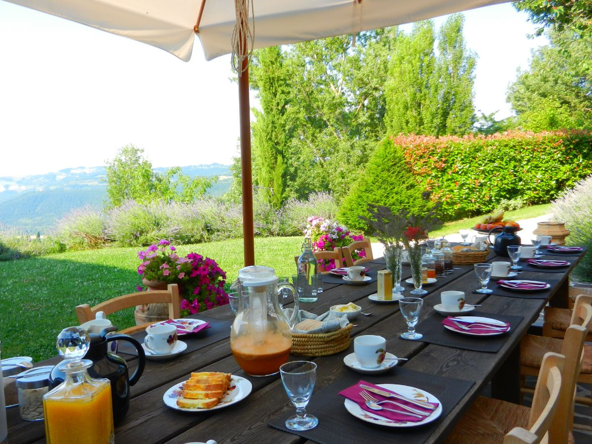 Breakfast on the terrace at Bellaugello Gay Guest House, Italy